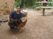 A picture of woman and her new chickens
